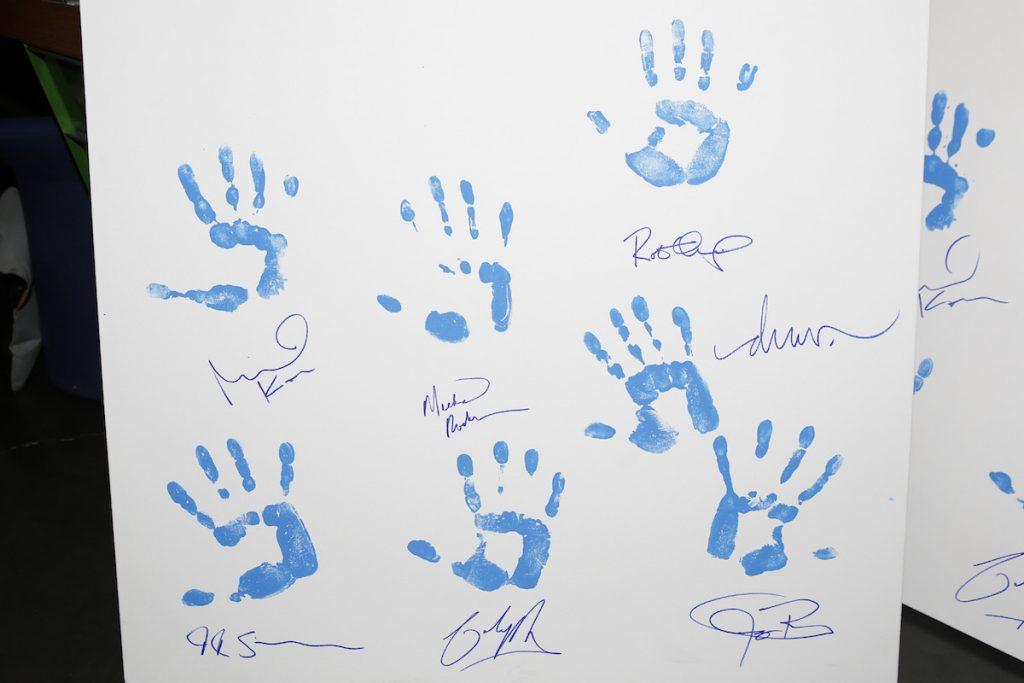 Aiding Australia Handprint/Signature Canvas with Robert Downey Jr., Jeremy Renner, Michael Keaton, JK Simmons, Michael Rosenbaum, Colin Hay