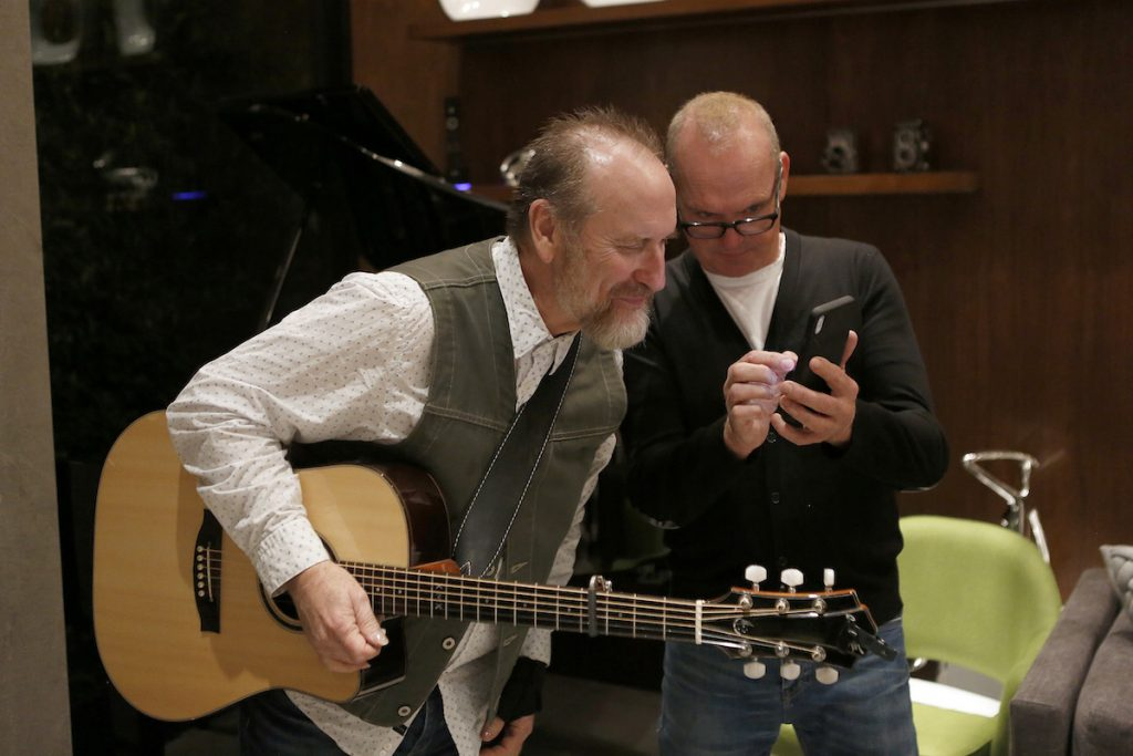 (left to right) Colin Hay of 'Men at Work' and Michael Keaton at the Aiding Australia Benefit Event. (Photo by: David Yeh)