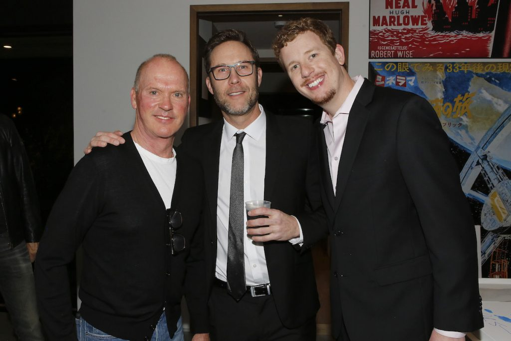 (left to right) Michael Keaton, Michael Rosenbaum of Inside of You with Michael Rosenbaum Podcast, and host Byron Burton at the Aiding Australia Charity Event. (Photo by: David Yeh)