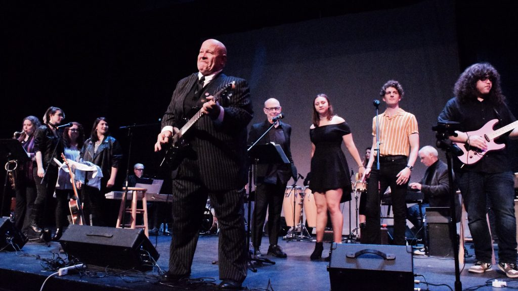 """UBU Project Founder David Simmons, Academy Award-winning actor JK Simmons, and several talented youth performers rock the house at the """"Light Your Corner of the World"""" benefit concert."""