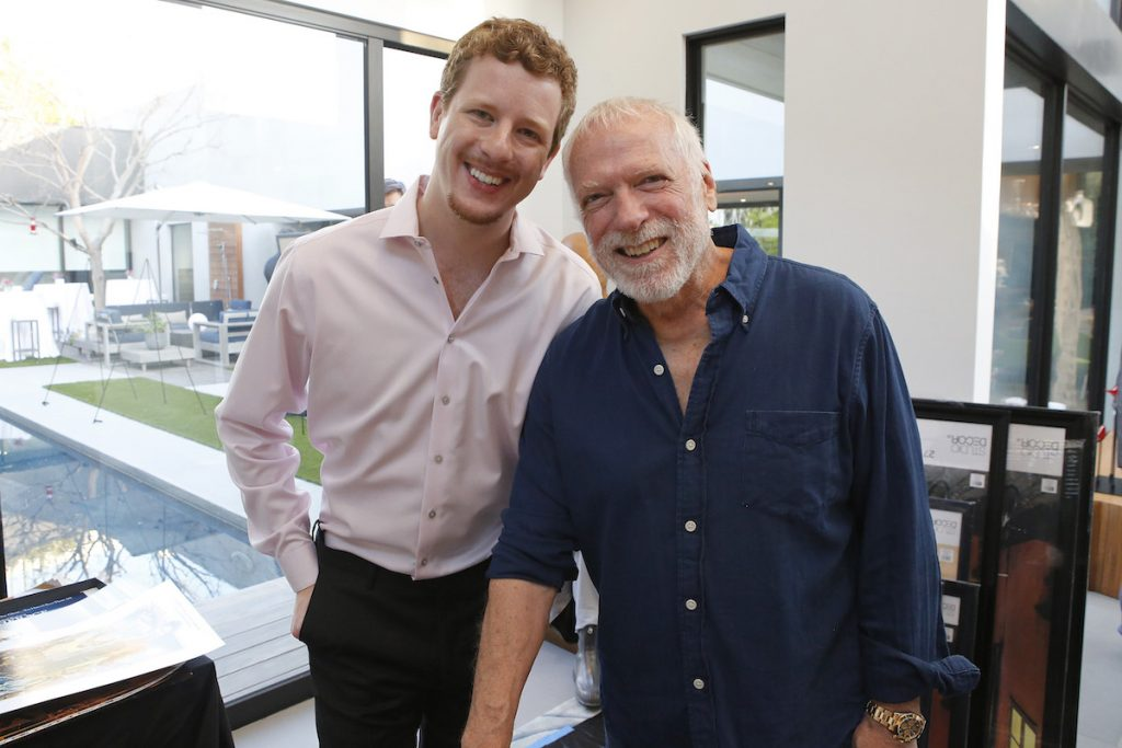(left to right) Host Byron Burton and artist Drew Struzan at the Aiding Australia Charity Event. (Photo by: David Yeh)