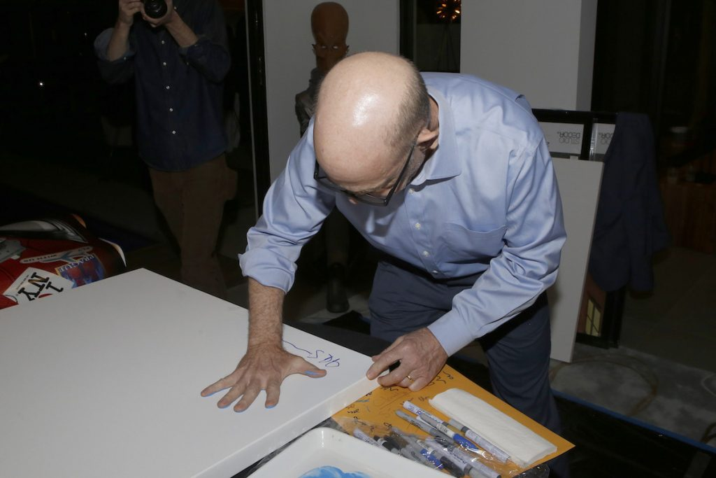 JK Simmons signing items for the Aiding Australia Benefit. (Photo by: David Yeh)