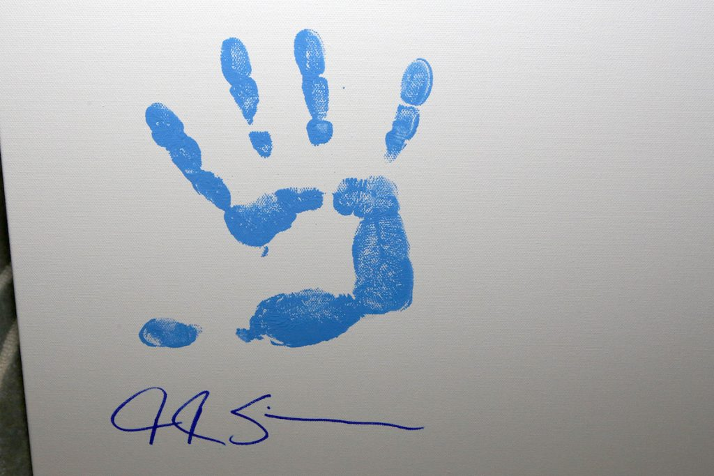 JK Simmons handprint item for the Aiding Australia Benefit. (Photo by: David Yeh)