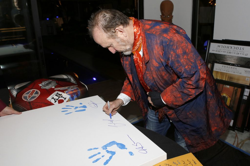 Colin Hay of 'Men at Work' signing items for the Aiding Australia Benefit. (Photo by: David Yeh)