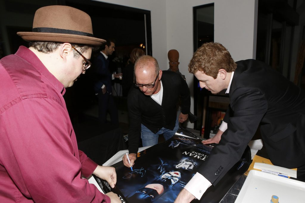 Michael Keaton signing items for the Aiding Australia Benefit. (Photo by: David Yeh)