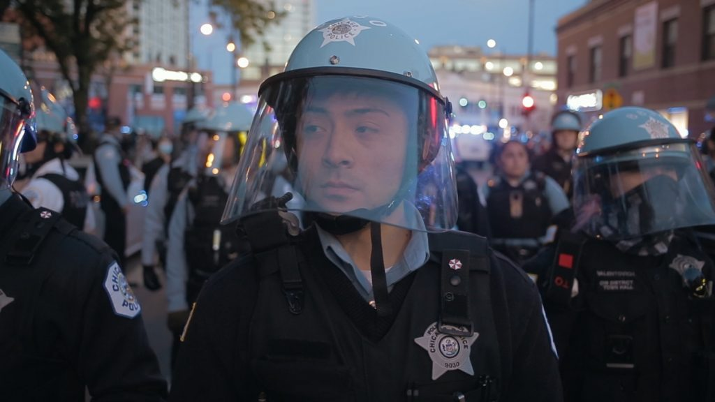 A police officer during a protest in Steve James' CITY SO REAL.