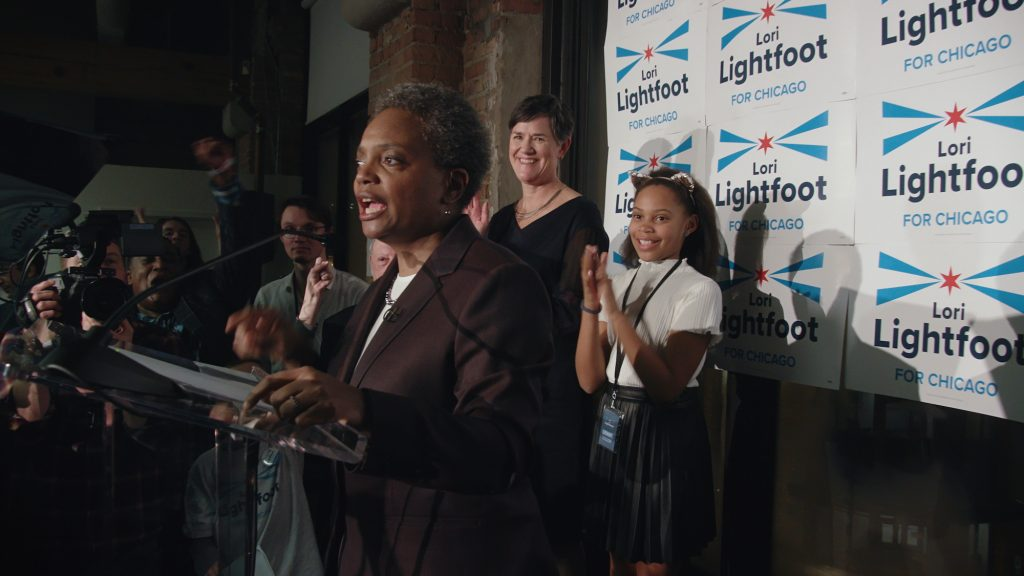 Lori Lightfoot delivers her victory speech with her family in the background after winning the Chicago Mayor's race in 2019 in Steve James' CITY SO REAL.