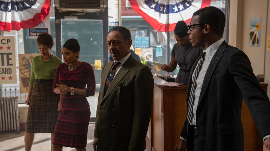 Powell (Giancarlo Esposito) reacts to the news of Kennedy's assassination in GODFATHER OF HARLEM