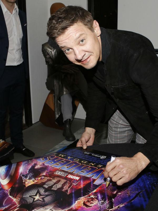Jeremy Renner signing Avengers: Endgame Poster for Aiding Australia