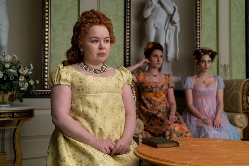 Nicola Coughlan as Penelope Featherington, Bessie Carter as Prudence Featherington, and Harriet Cains as Phillipa Featherington in Netflix's BRIDGERTON