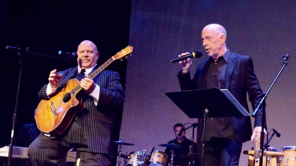 "UBU Project Founder David Simmons and actor JK Simmons perform a song at the ""Light Your Corner of the World"" benefit concert. (Photo: Kristy Sproul)"