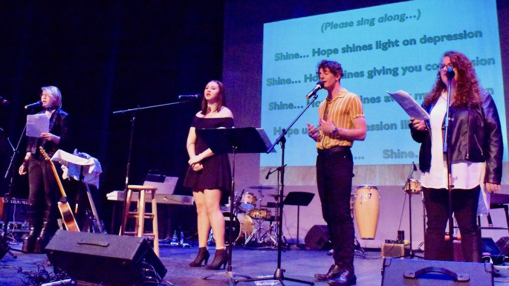"""Youth performers (left to right) Phoebe Marlowe, Cheyenne Newberry, Isaiah Tilson, and Danica Rollier perform at the """"Light Your Corner of the World"""" benefit concert. (Photo: Kristy Sproul)"""